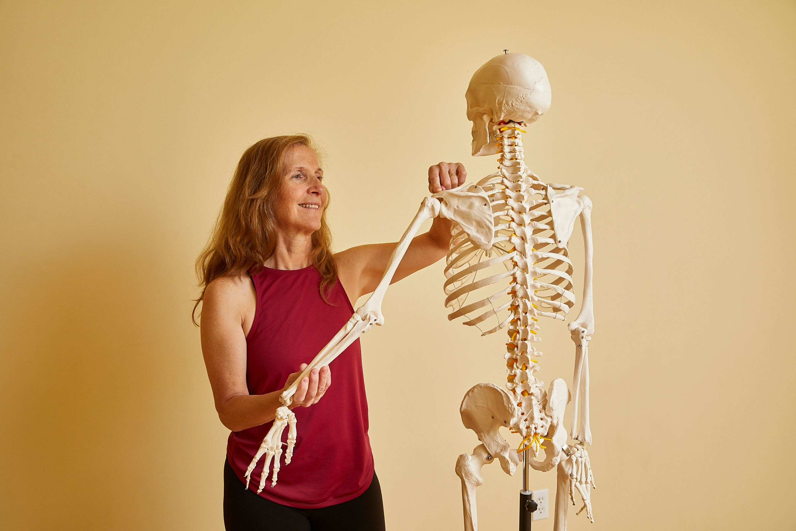 Nora with her skeleton showing how the shoulder joint moves